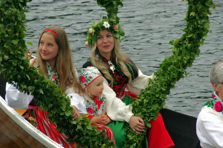 Attendees celebrate the Midsummer holiday in Sweden
