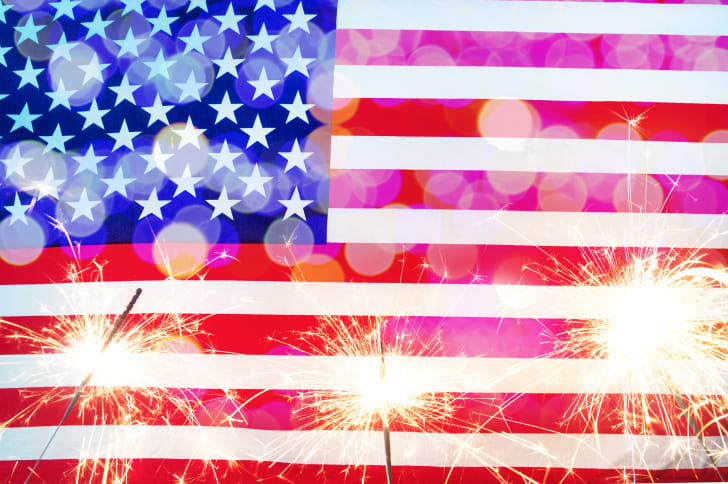sparklers in front of an American flag