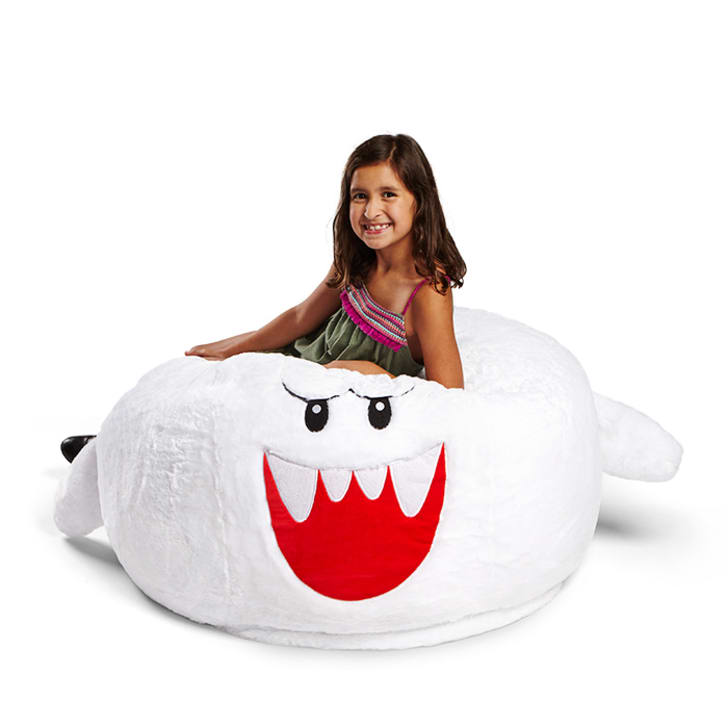 A girl on a Super Mario bean bag chair