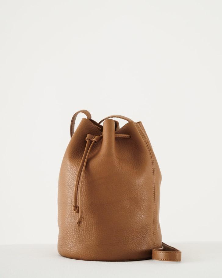 A brown drawstring purse