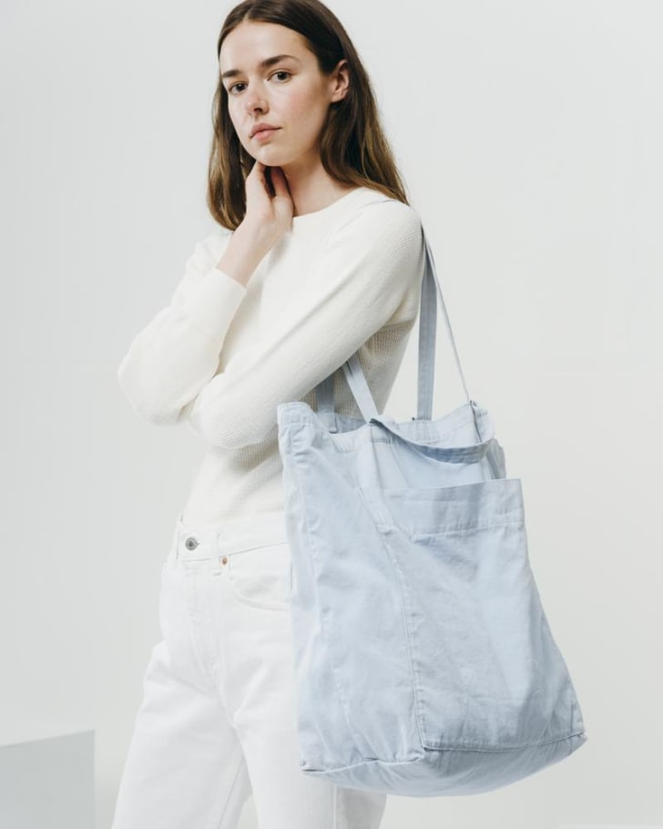 A woman carrying a Baggu Giant Pocket Tote