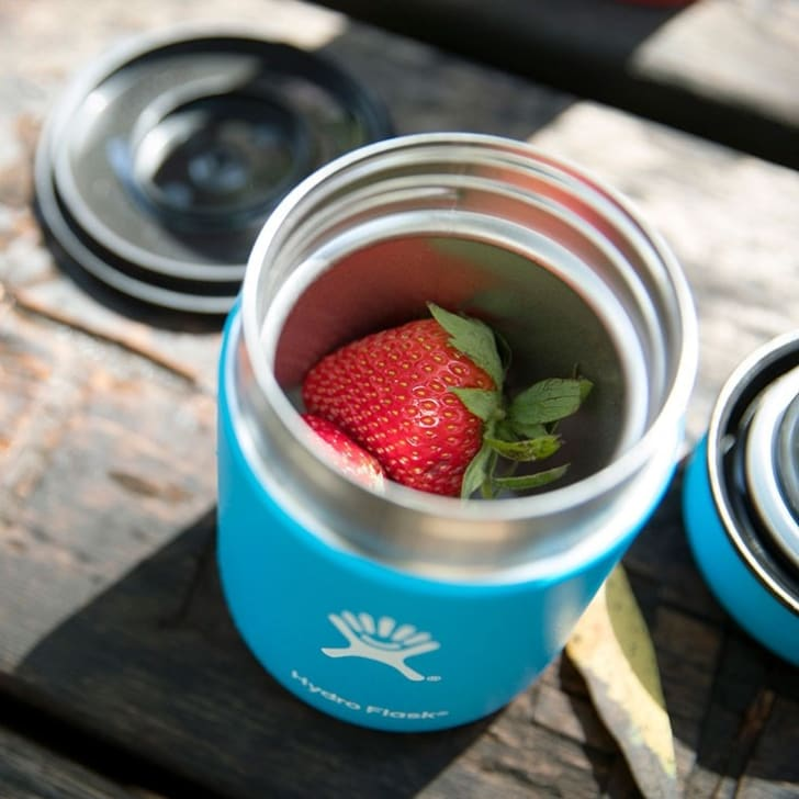 A Hydro Flask food flask with strawberries in it