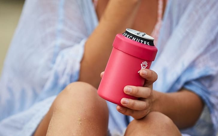 A woman holding a Cooler Can