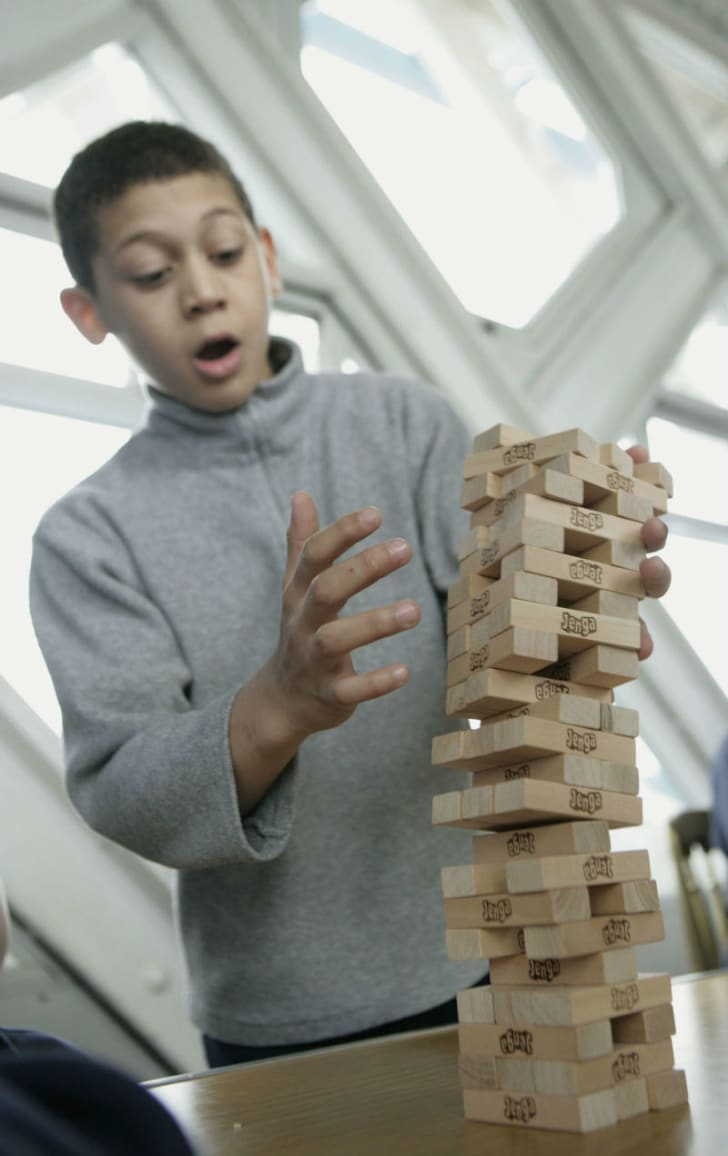 A student competes to break a Guinness World Record of 30 'Jenga' levels in 11 minutes and 55 seconds in London in 2005