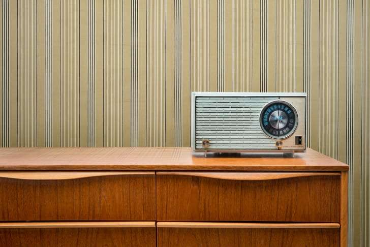 Vintage radio sitting on a mid-century dresser
