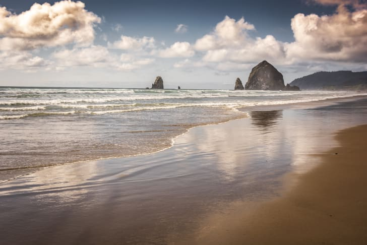 Cannon Beach, Oregon, with clouds reflected in the shore