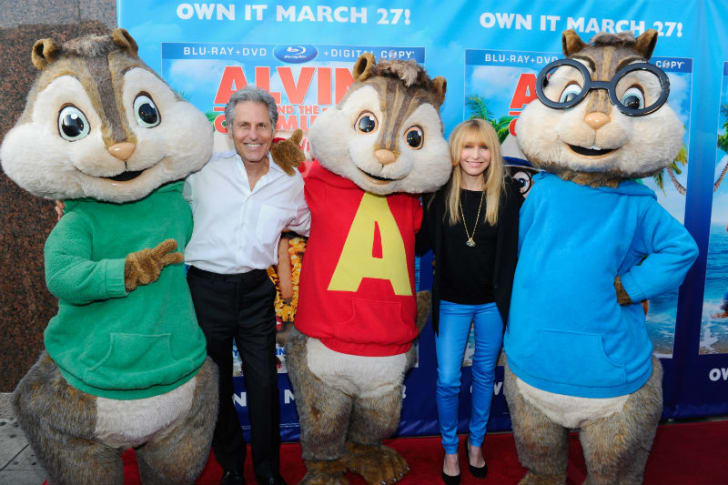 Costumed versions of Alvin and the Chipmunks appear in a photo standing next to Ross Bagdasarian Jr. and his wife, Janice Karman