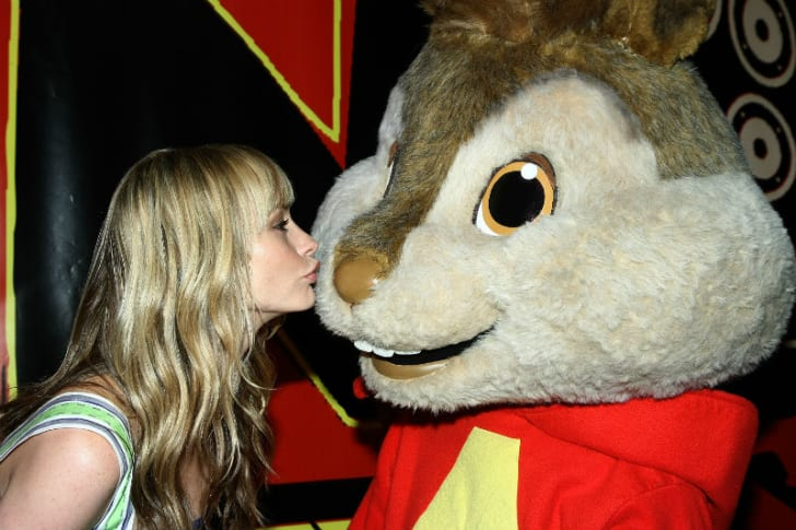 A costumed version of Alvin receives a kiss from actress Cameron Richardson during a public appearance