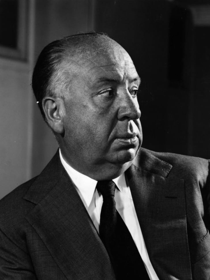 Director Alfred Hitchcock poses for a publicity photograph