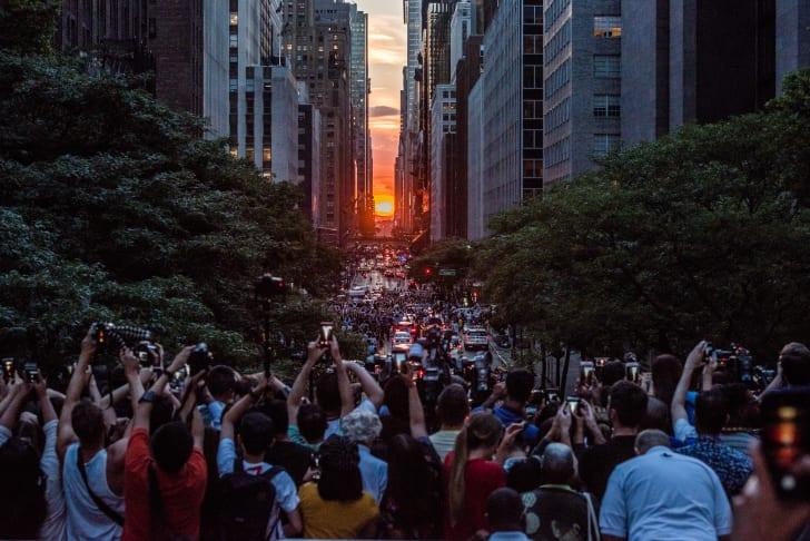 People taking pictures of Manhattanhenge