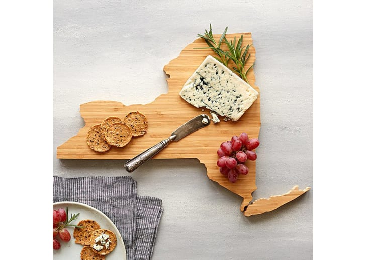 A cheese board in the shape of New York state