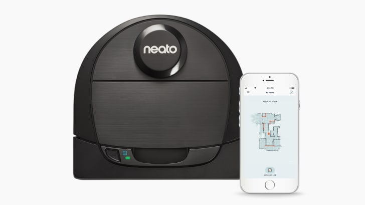 A Neato Botvac D6 Connected next to an iPhone with the app open to a home's floorplan