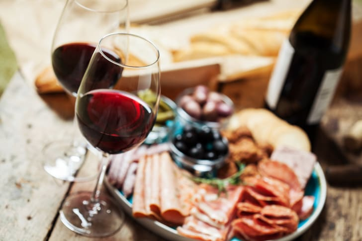 Glasses of red wine and charcuterie