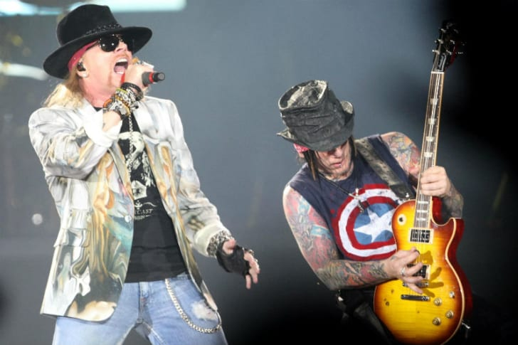 Axl Rose and DJ Ashba of Guns 'N Roses are seen performing on stage