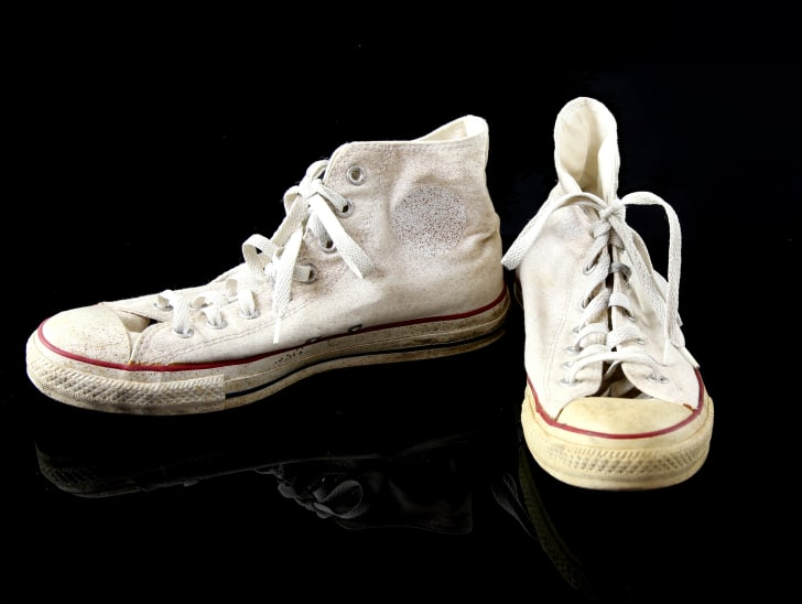 A pair of cream-colored Converse sneakers from the set of 'Doctor Who'