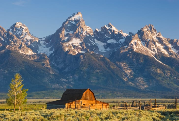 A barn framed by mountains