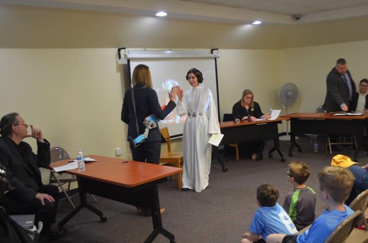 Princess Leia is sworn in to take part in the trial of Luke Skywalker