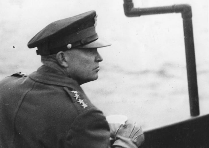General Dwight D Eisenhower watches the Allied landing operations from the deck of a warship in the English Channel on D-Day.