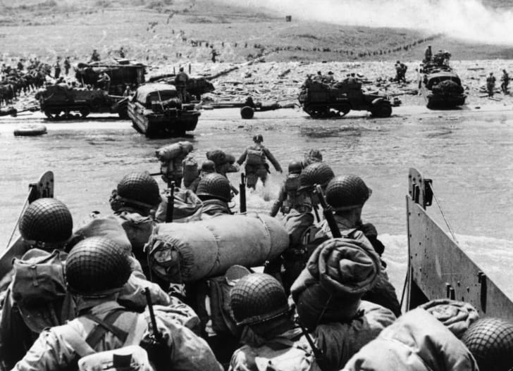 American assault troops and equipment landing on Omaha beach on the Northern coast of France.