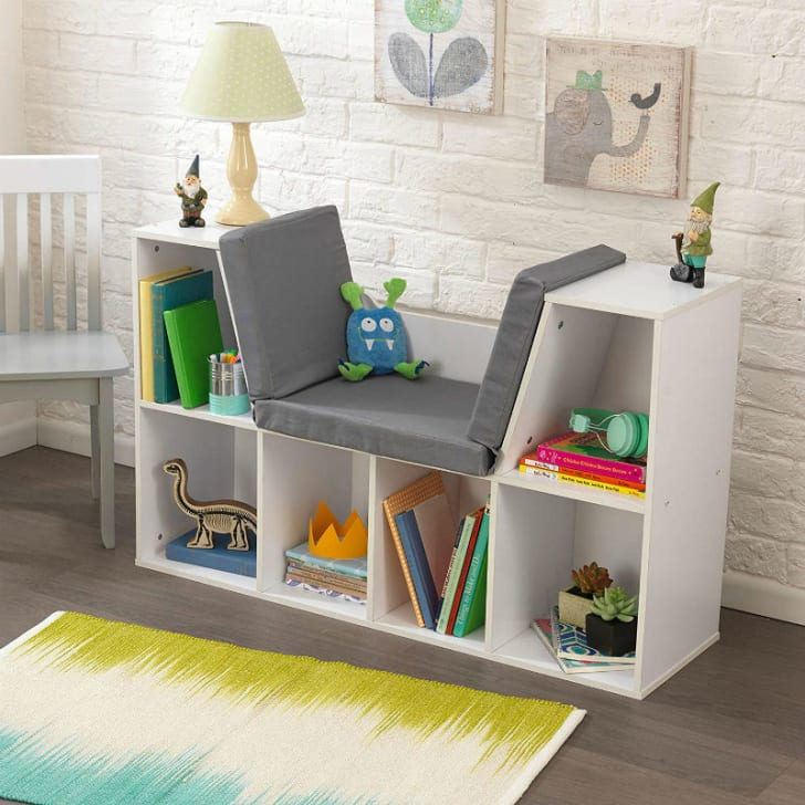 A KidKraft Bookcase with toys and books in it
