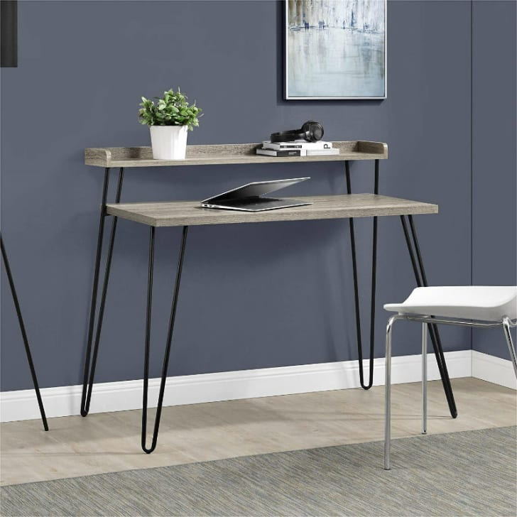 An Ameriwood Home Haven Retro Desk with a laptop on it