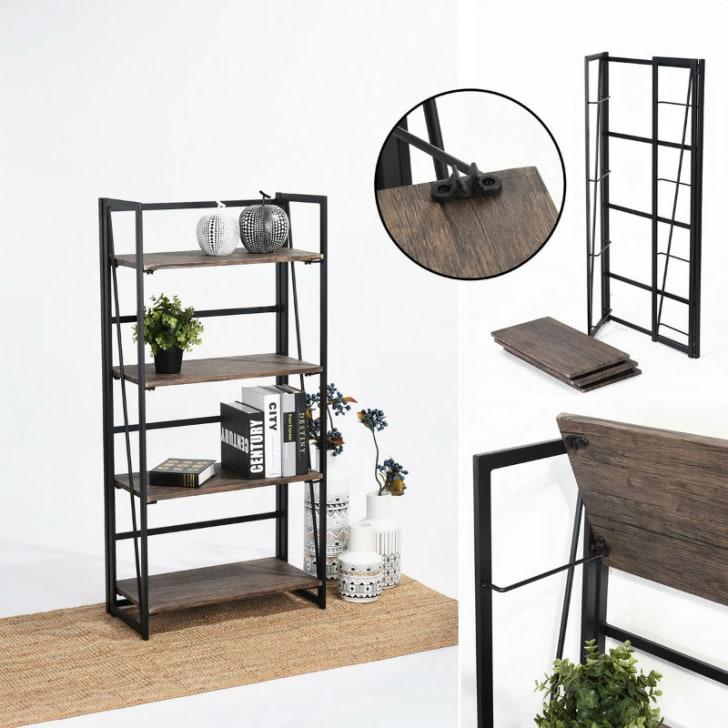 A Coavas folding book shelf with plants and books on it