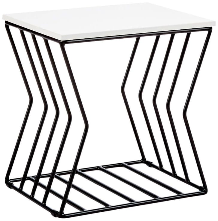 A Now House by Jonathan Adler Concave Grid Accent Table is pictured