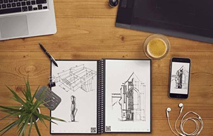 A Rocketbook notebook with drawings in it on a desk