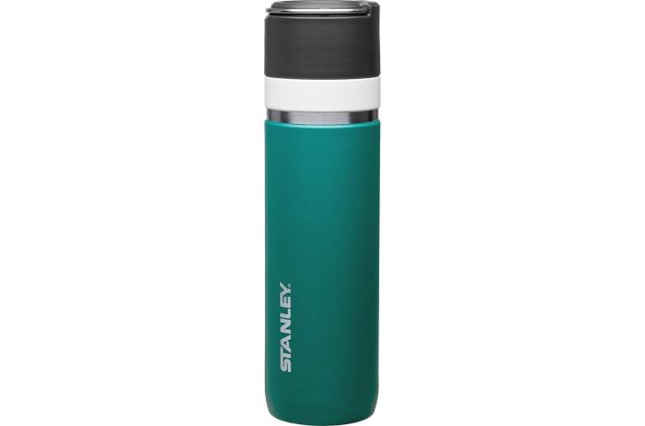 A green Stanley bottle