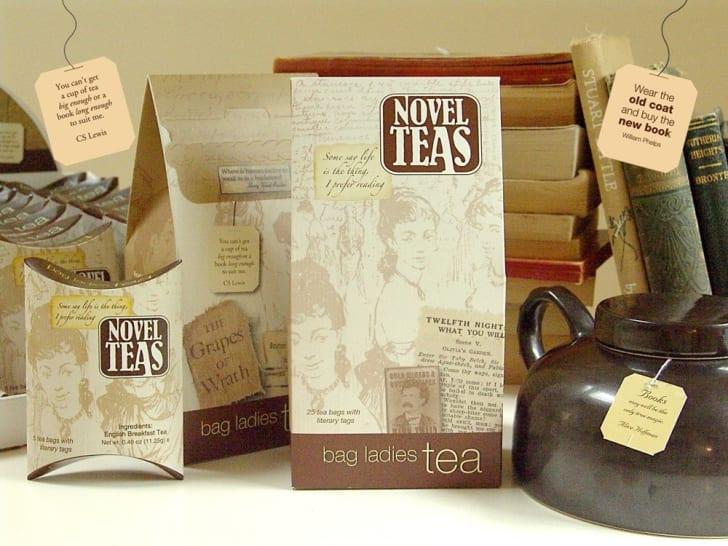 'Novel Teas' boxes on a table next to a kettle