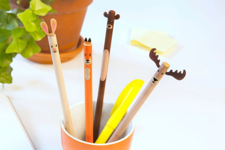 Pencils with tops that look like animals sitting in a cup