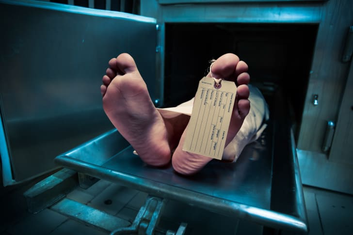 Feet on a morgue table with toe tag