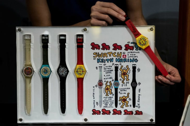 A selection of Swatch watches designed by artist Keith Haring are seen on display