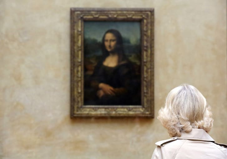 The Mona Lisa hanging in the Louvre