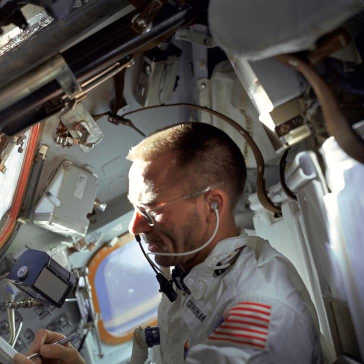 NASA astronaut writing with a space pen