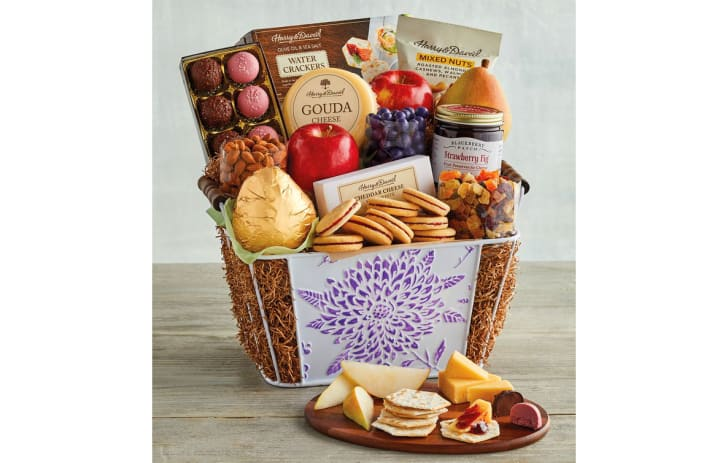 A Mother's Day gift basket filled with cheese, cookies, and more