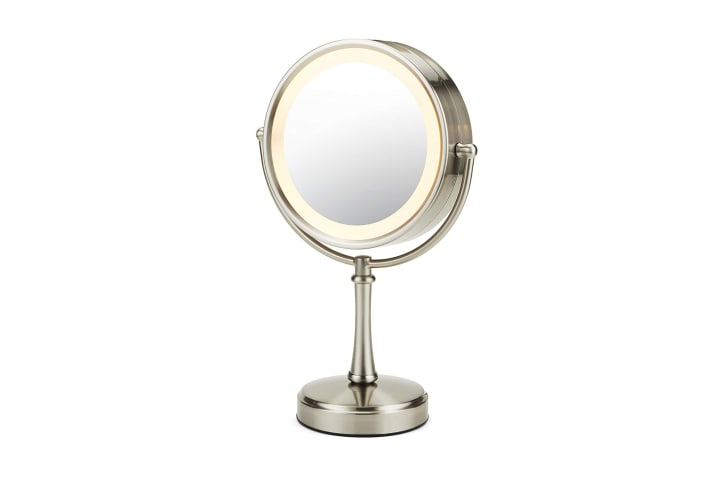 A round makeup mirror with a lighted edge