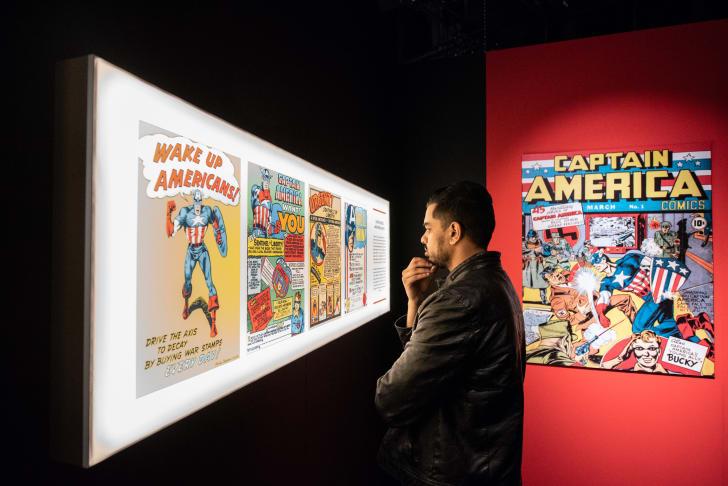 A man looks at a comics display
