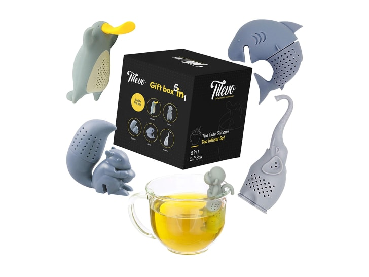 Tea infusers shaped like a platypus, a shark, a squirrel, a monkey, and an elephant with a cup of tea