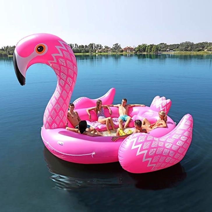 Inflatable flamingo with people on it