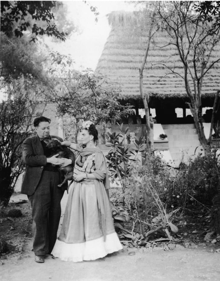Frida Kahlo with Diego Rivera and a pet dog, Mexico City, 1940s