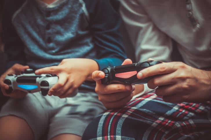 Close up of father and son playing video game