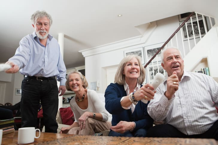 Group of senior friends playing video games