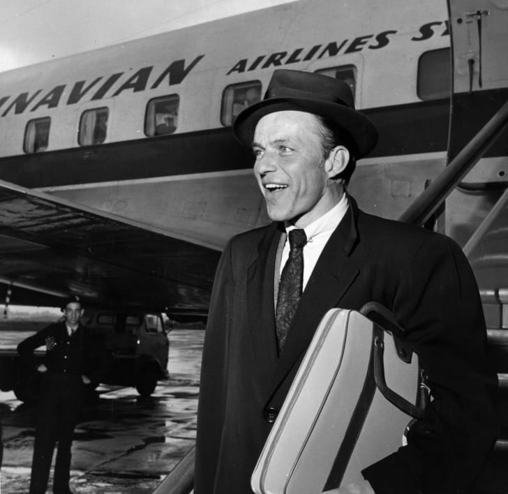Frank Sinatra at an airport in 1956