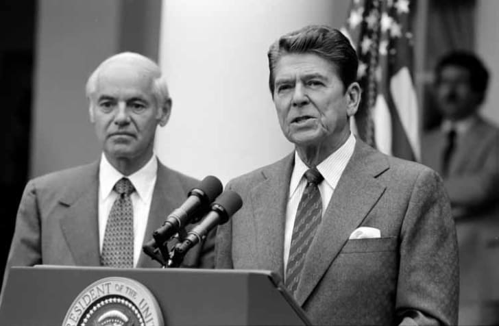 President Reagan with William French Smith making a statement in the Rose Garden in 1981.