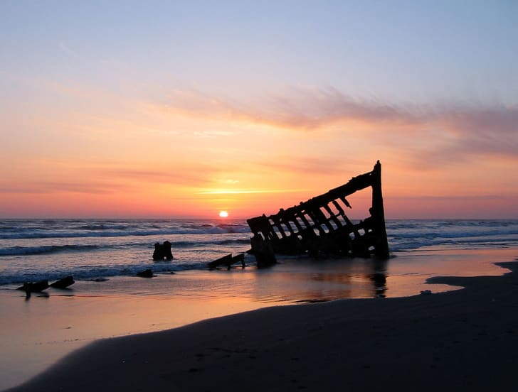 The wreck of the Peter Iredale in the Fort Stevens State Park, Oregon, USA, at sunset