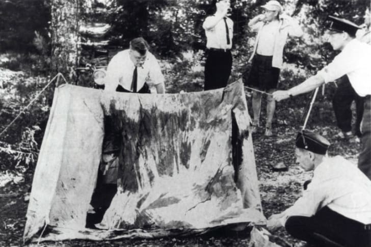 Finnish investigators examine the Lake Bodom crime scene in Espoo, Finland in June 1960