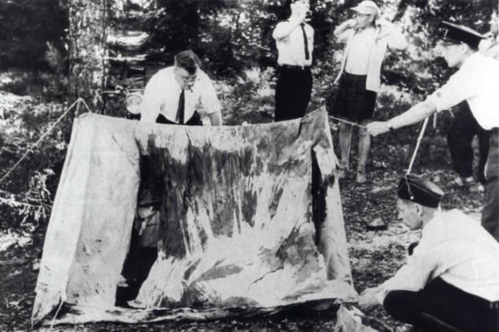 Finnish investigators examine the Lake Bodom crime scene in Espoo, Finland in June 1960