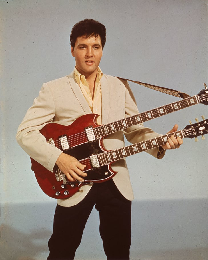 Elvis Presley is seen playing the guitar in his 1966 film, 'Spinout'