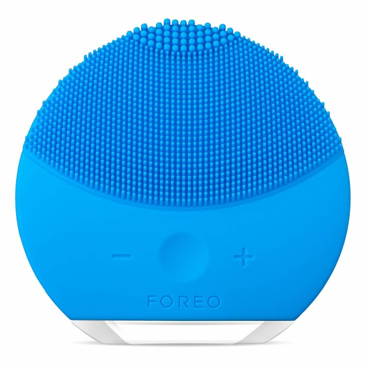 A blue facial cleansing brush